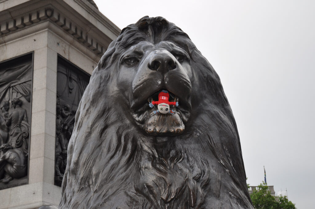 Puppet What What making friends with the famous Lions of London's Trafalgar Square.