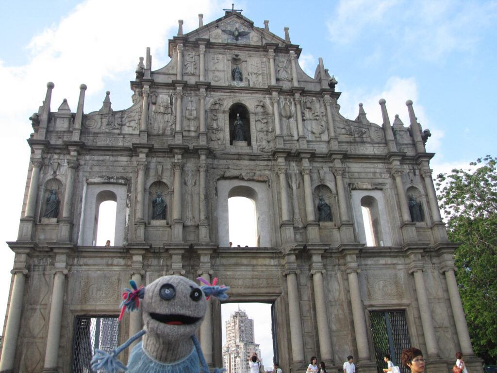 Puppet What What outside of the The Ruins of Saint Paul's in Macau, China.